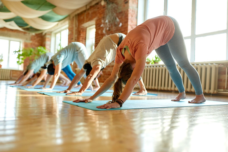 four people doing yoga at a yoga studio