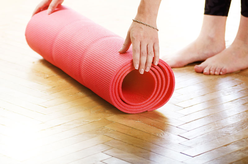 Yoga mat for person preparing to use yoga to help back pain