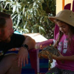 Interaction with Small Tortoise at Animal Birthday Party