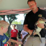 Alligator interaction at animal birthday party