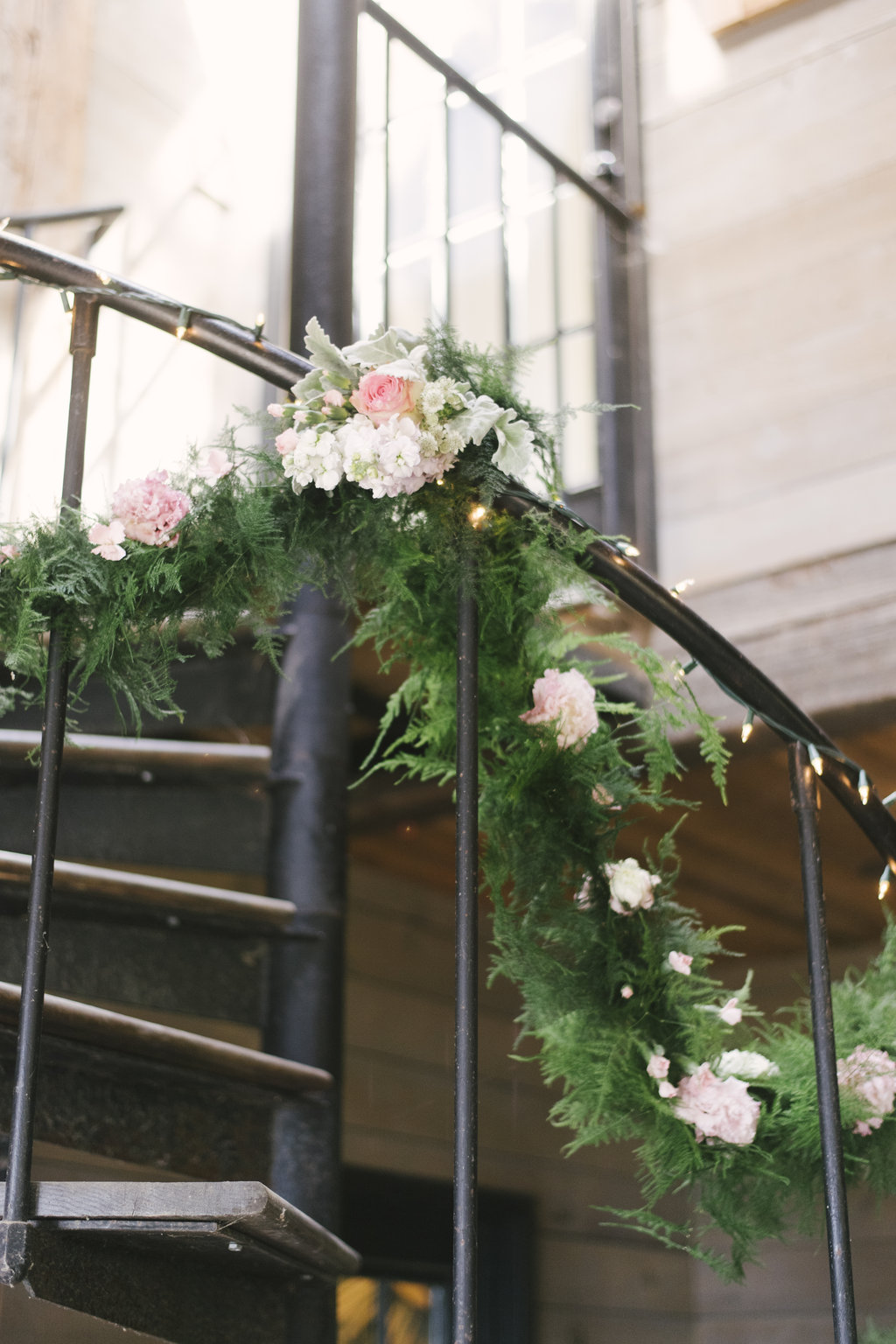 Mix up your greenery like we did here on this banister for a barn wedding in Westchester!