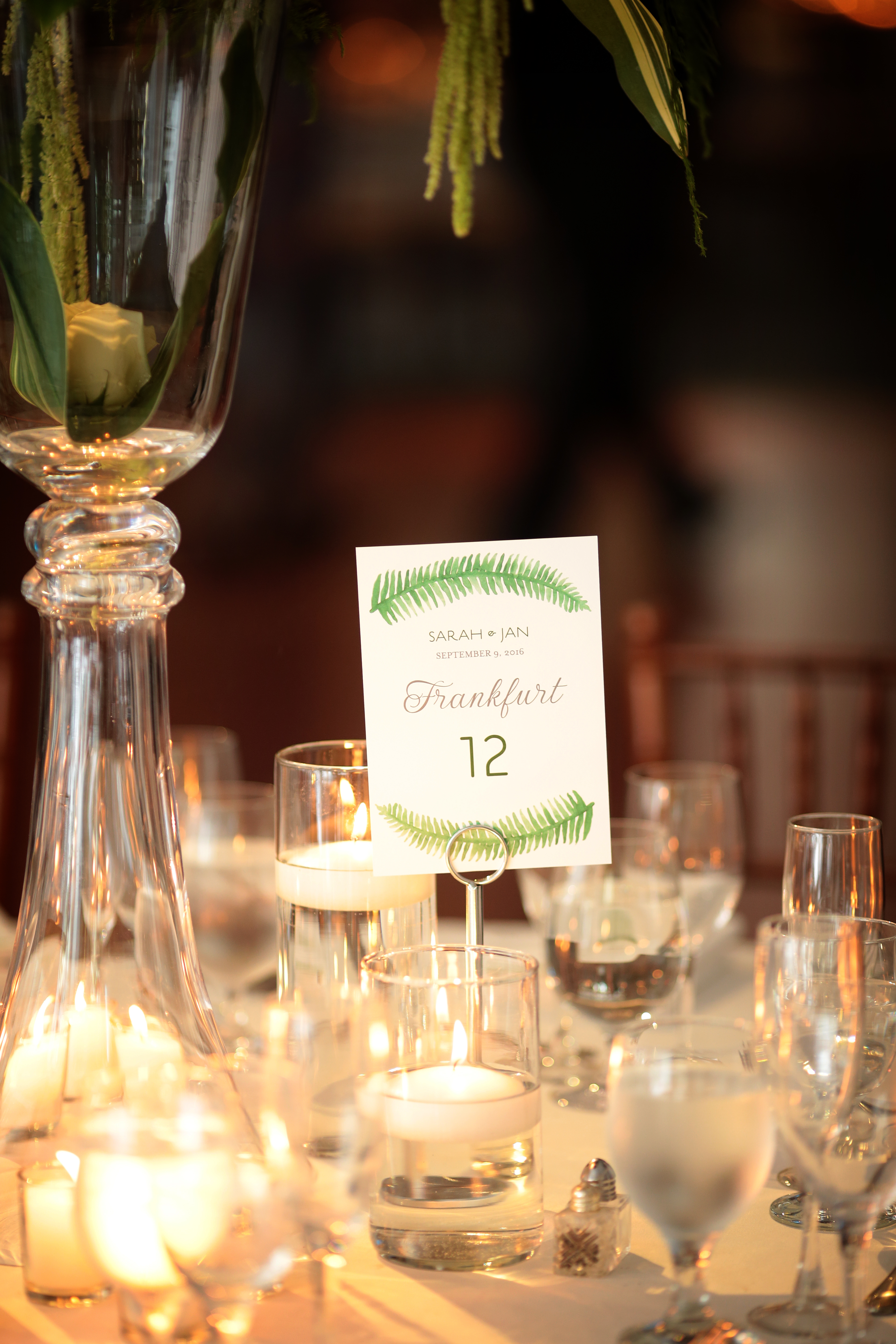 We incorporated greenery into the table names at this New York Botanical Garden Wedding for an added special touch!