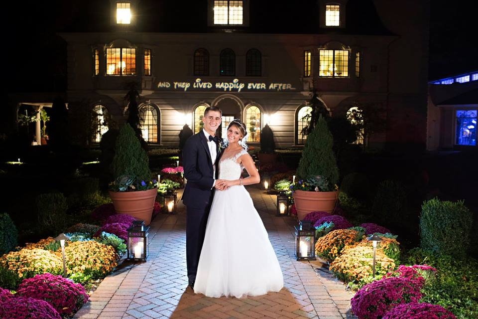 A Disney inspired wedding we designed at The Ashford Estate with our bride in a custom Reem Acra wedding gown and our groom in a classic black tuxedo.
