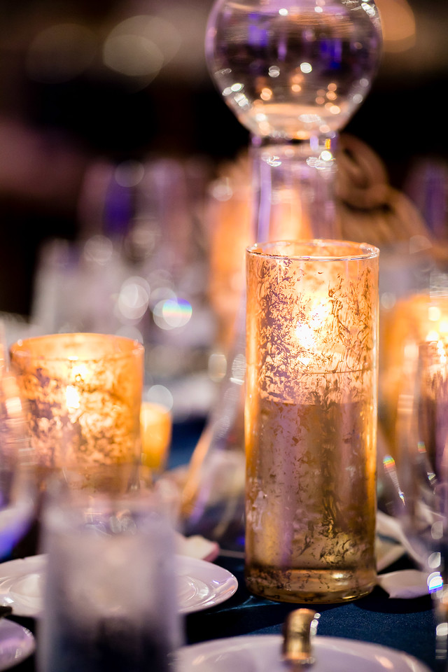 2018 wedding trends include lots of metallics like these gorgeous candle holders from a Fall wedding we designed. Read the blog for more trends and ideas.