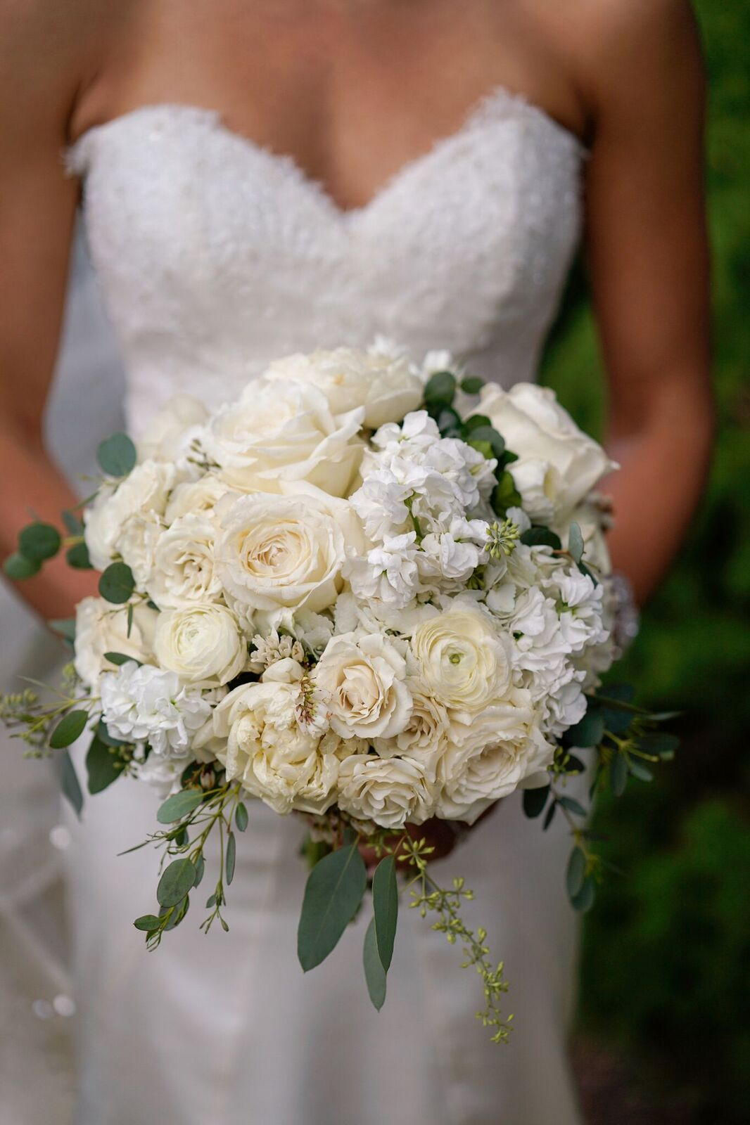A gorgeous all white bridal bouquet was the perfect elegant touch for this upscale garden wedding we planned.