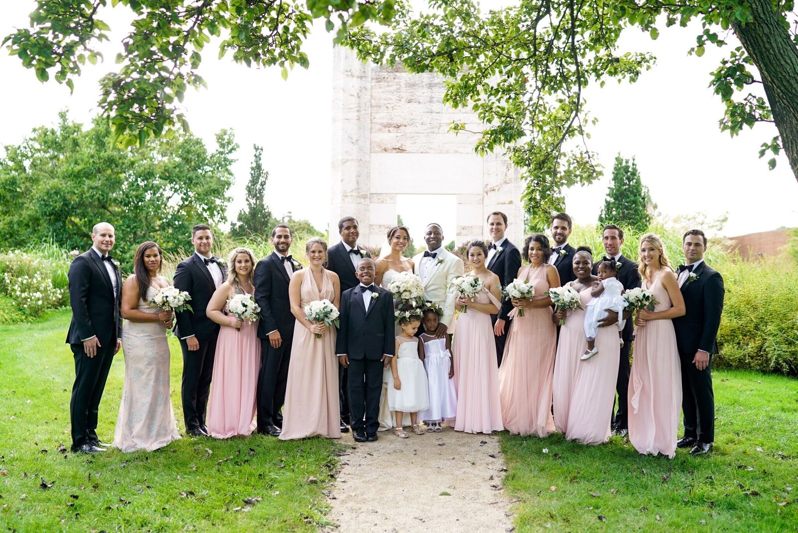 A chic garden wedding at Grounds for Sculpture in Princeton, New Jersey with white and green details to die for! Read the blog for wedding day inspiration!