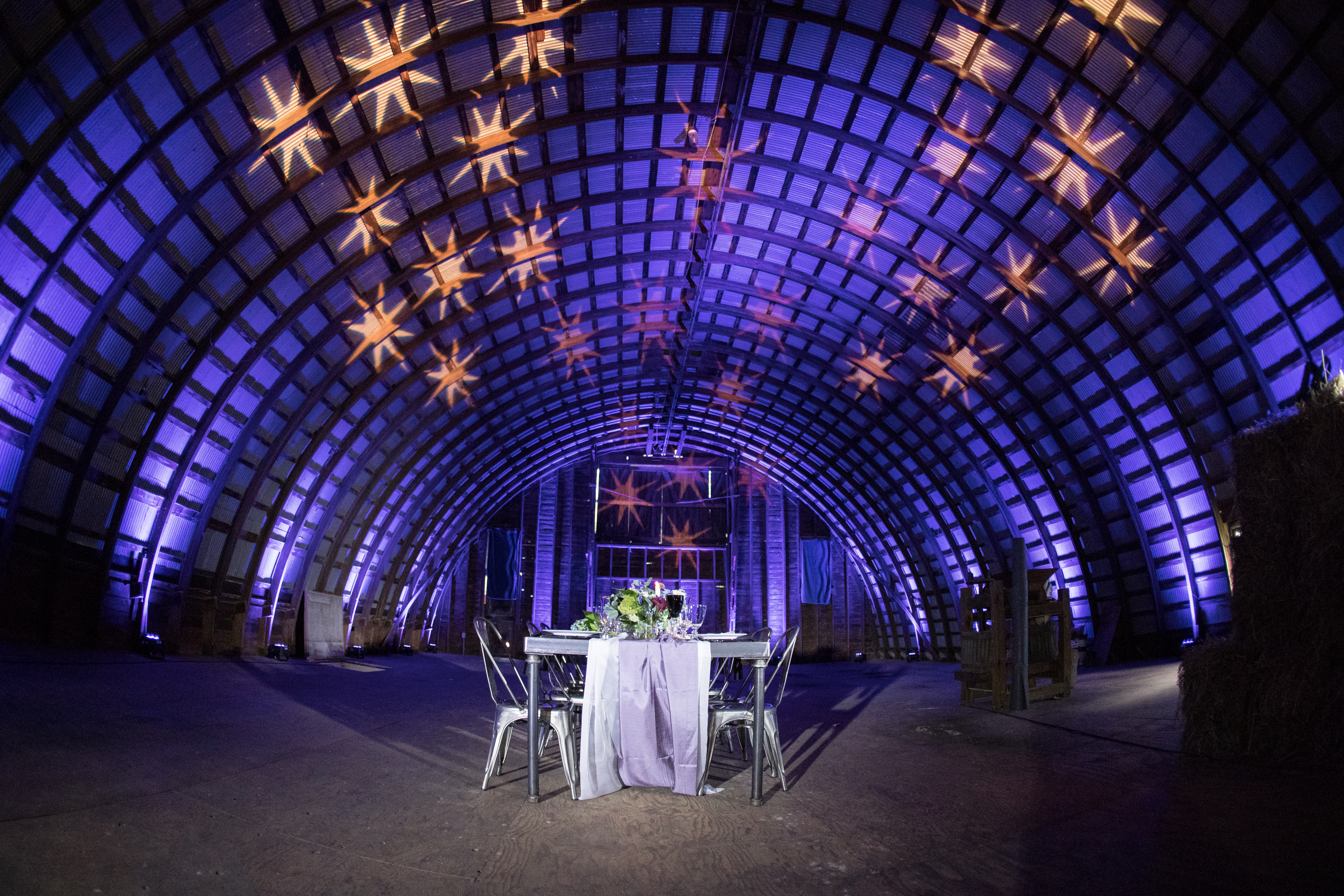 We decked out this barn in stars and plenty of purple for a totally rustic chic wedding.