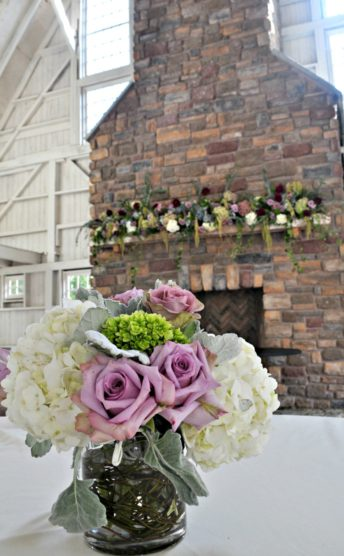 Wedding decor with a small arrangement and mantle design.
