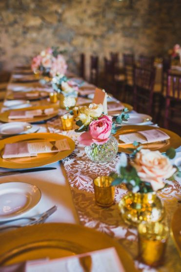 Pink, white and gold roses as wedding centerpieces
