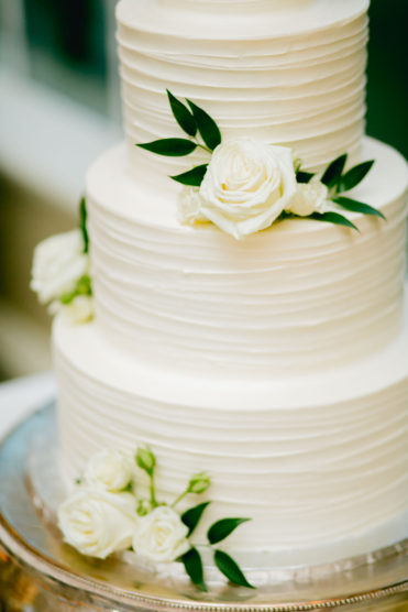 White wedding cake with real flowers