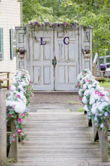 Outdoor wedding ceremony florals