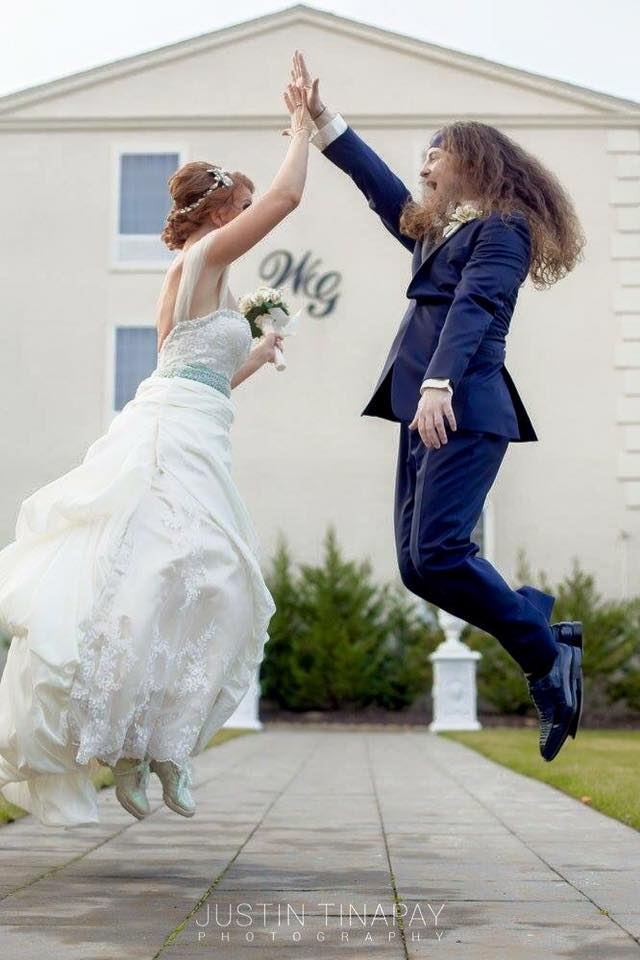 bride and groom high five