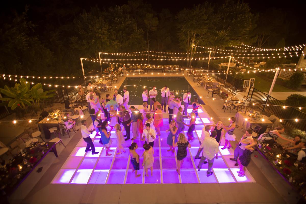 outdoor wedding with pool and dance floor