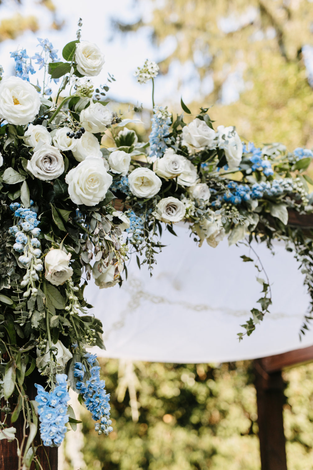 blue and white floral chuppah