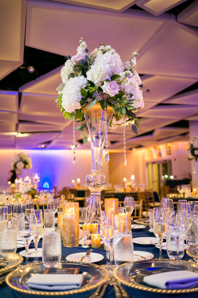 Tall white wedding centerpiece