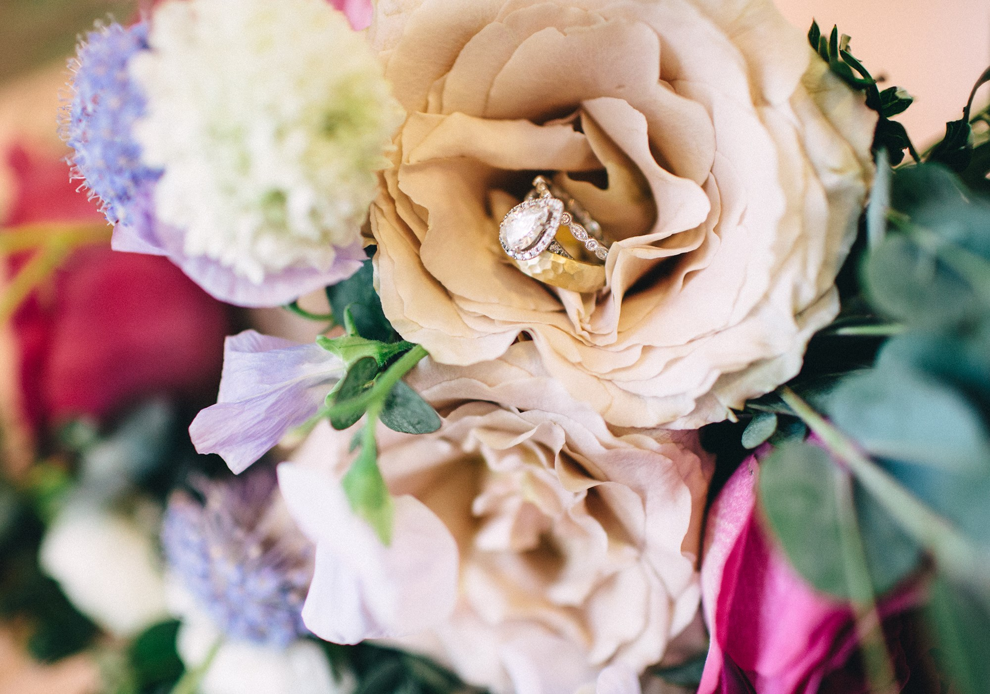 pear shaped engagement ring on bouquet