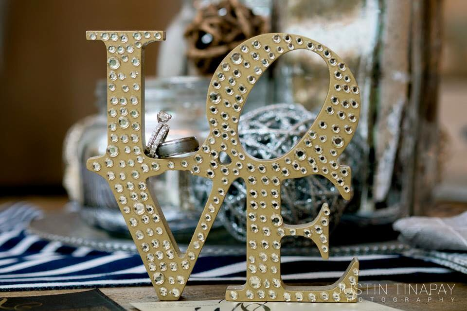 love sign with engagement ring and wedding band