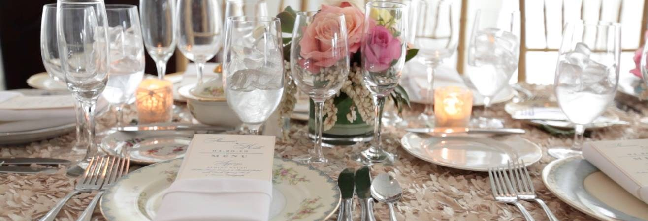long table at wedding reception in champagne linen with soft pink roses
