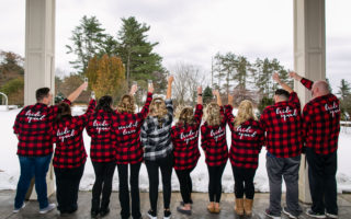 bride and bridal party in plaid toasting