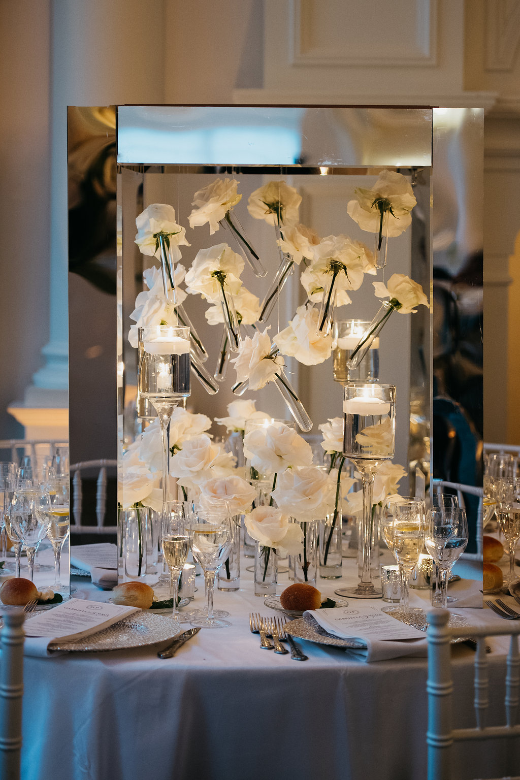 suspended white flowers in centerpiece at wedding