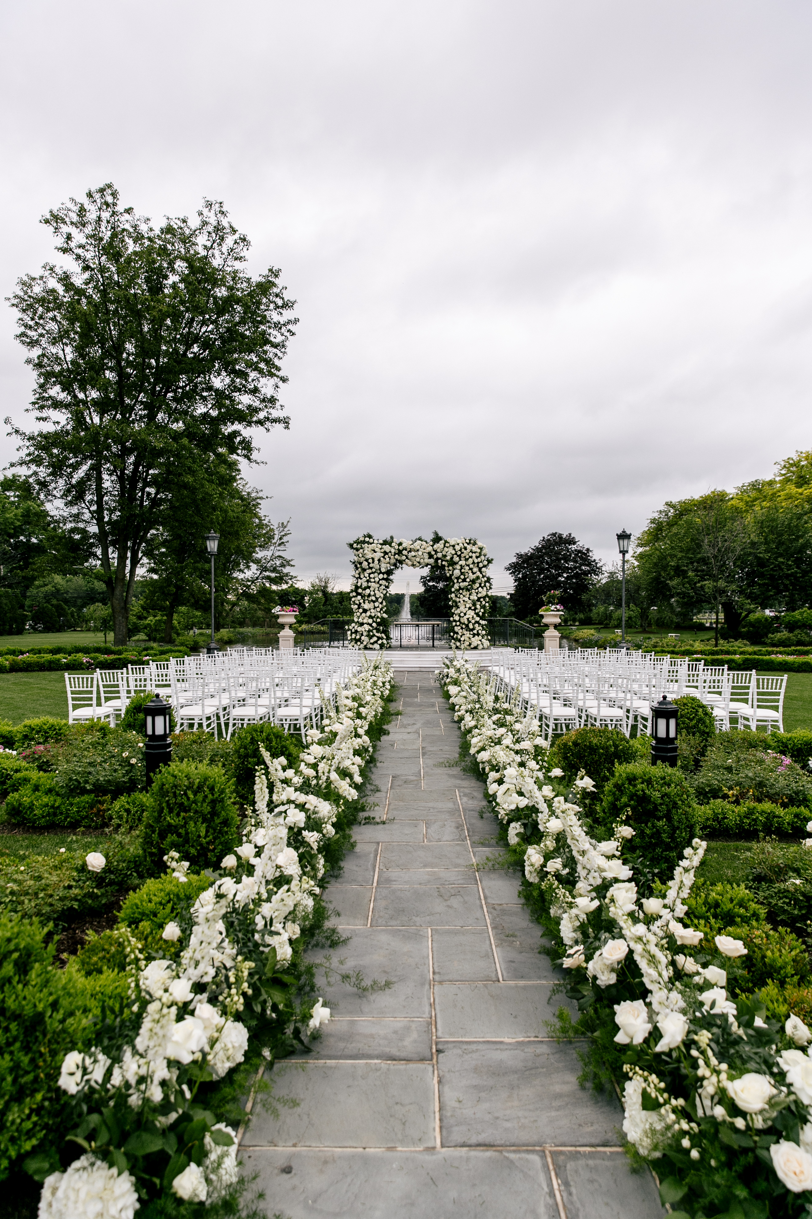 outdoor ceremony location with green and white flowers