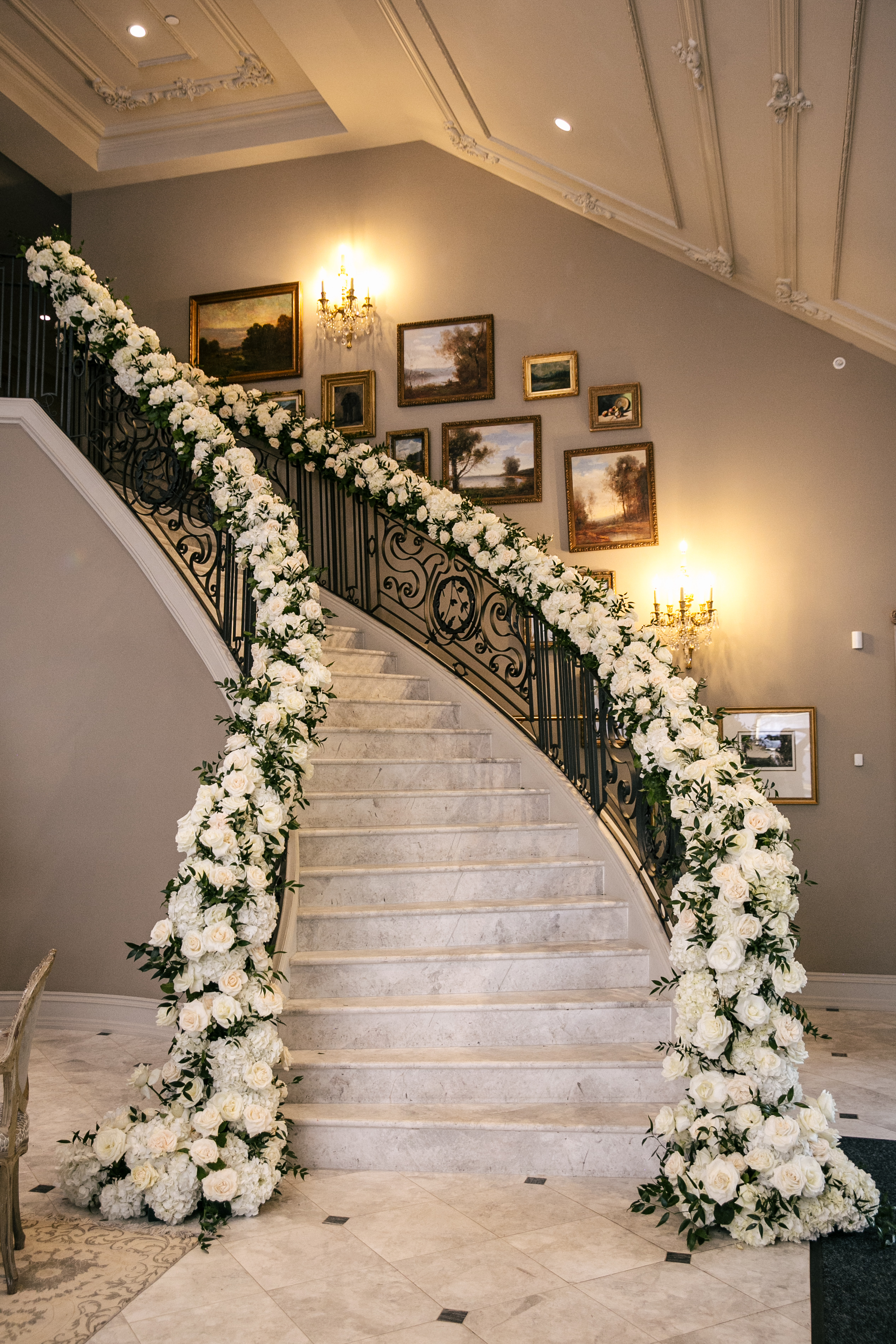 luxury wedding decoration with florals on banisters