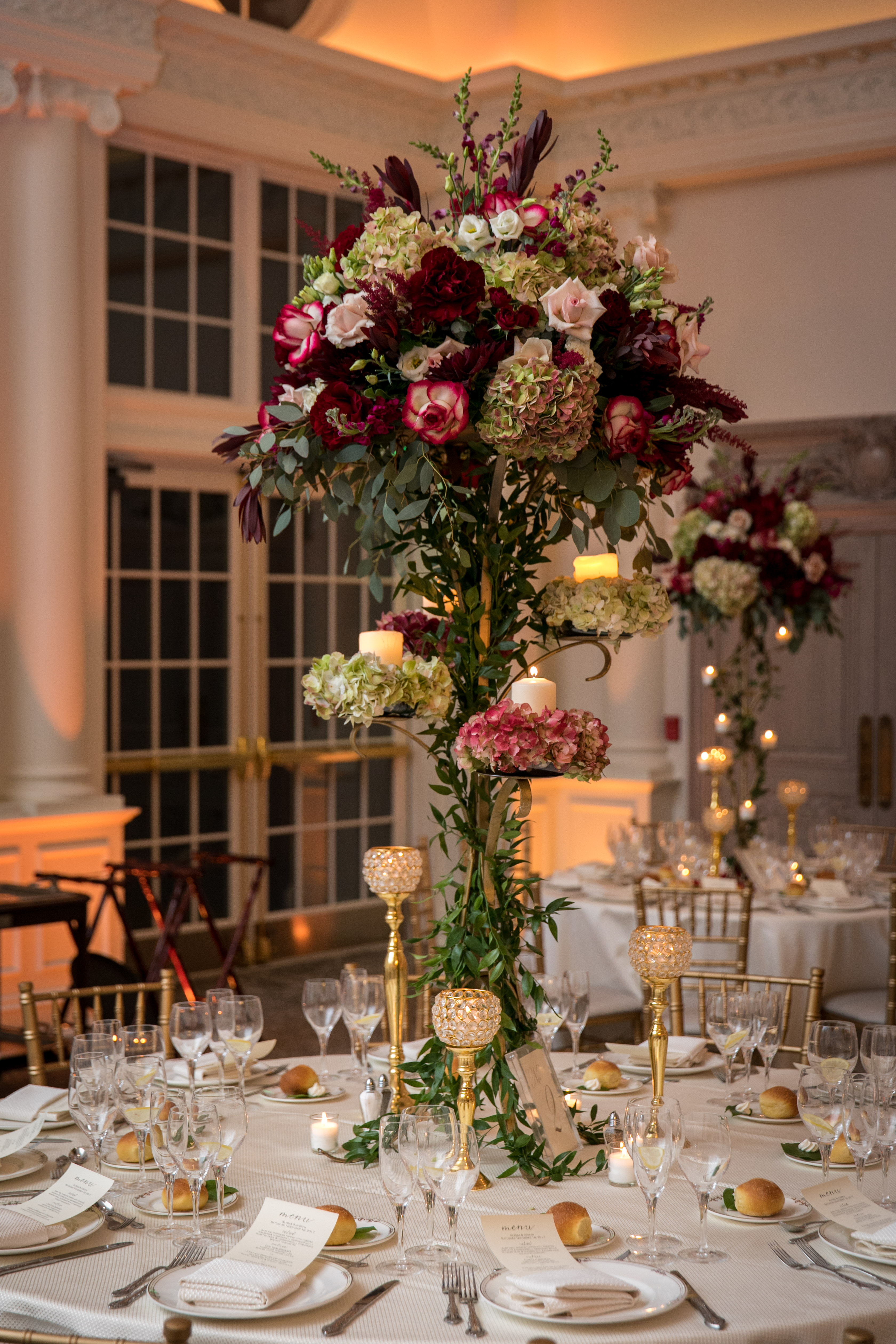 gorgeous tall centerpiece with red and green