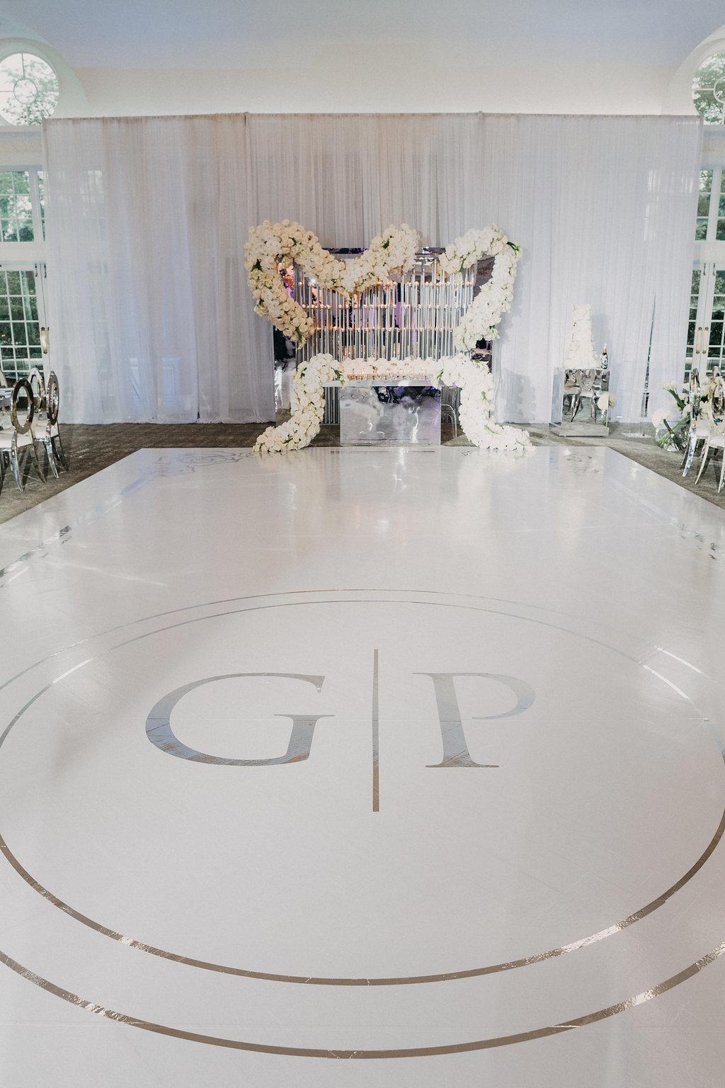 white dance floor with monogram