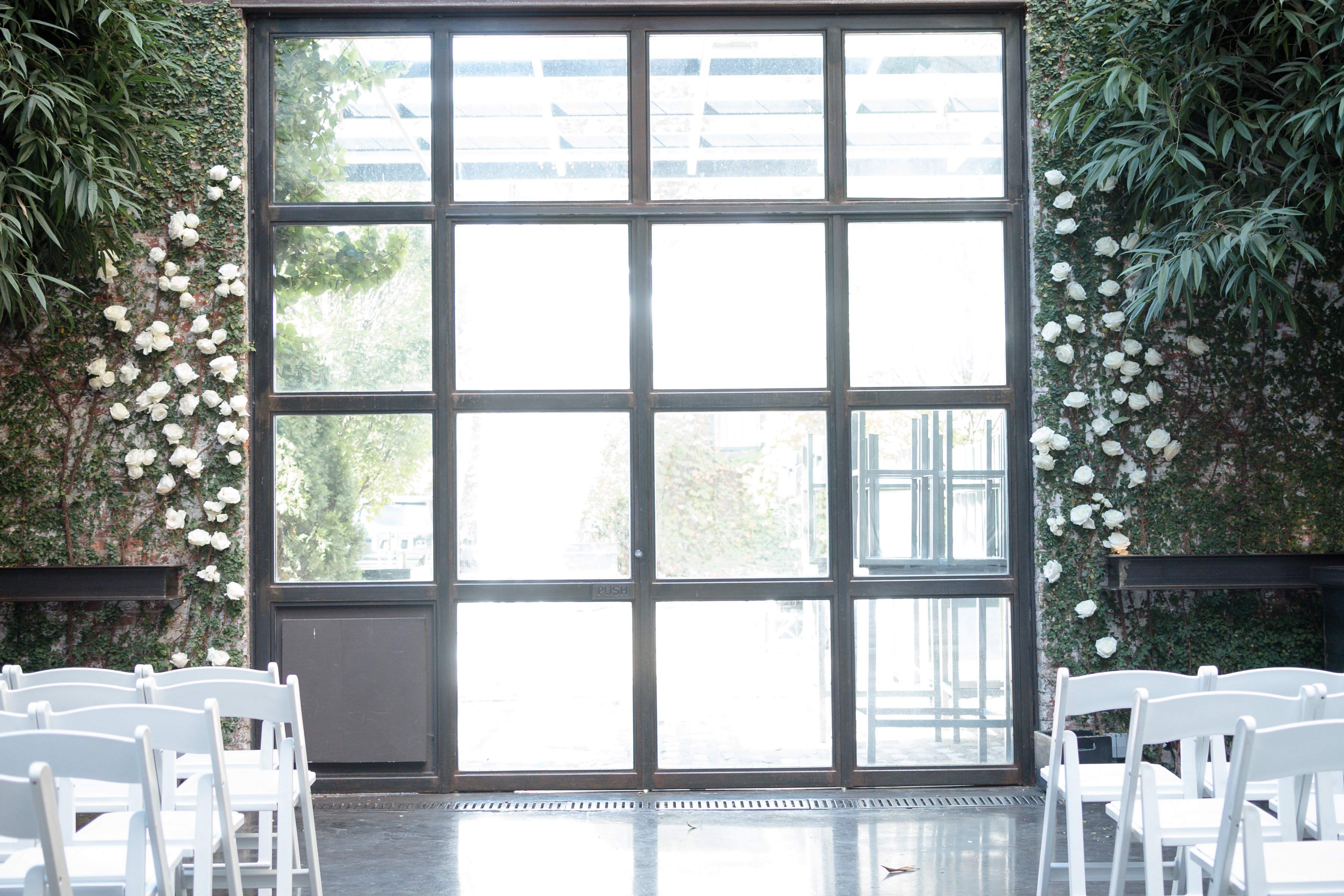 wedding ceremony site with green and white flowers