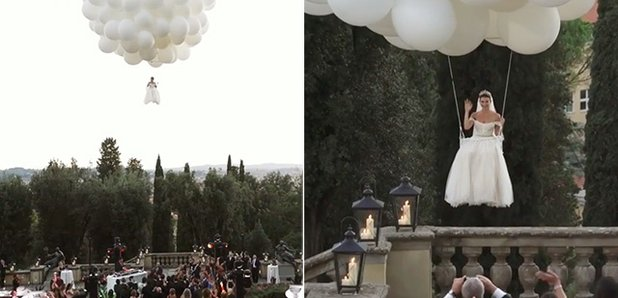 bride arriving to wedding ceremony flying in with white balloons