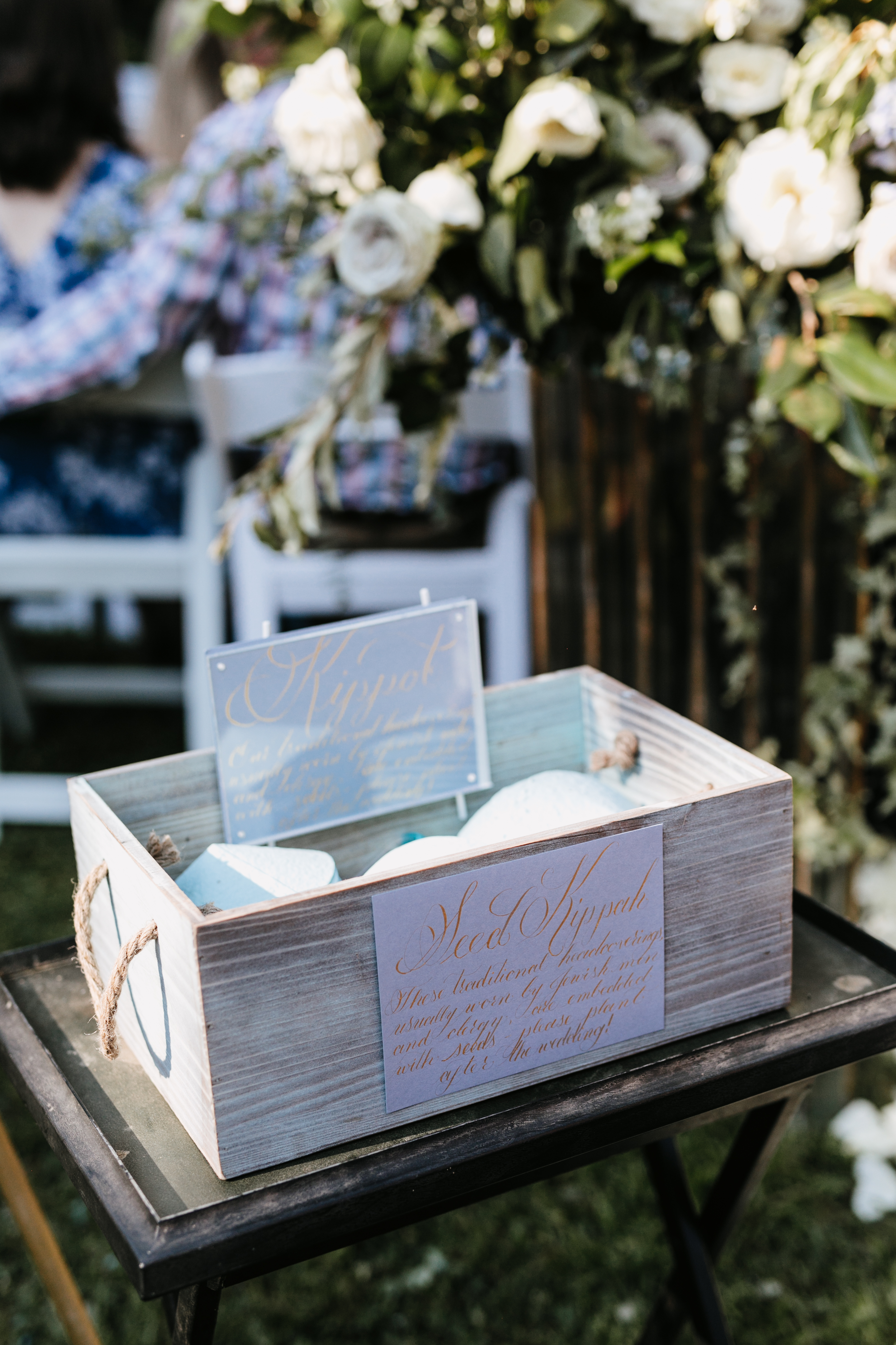 wooden box with ceremony programs