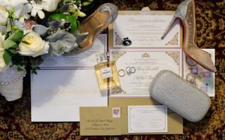 gold and white wedding invitations with red bottom shoes