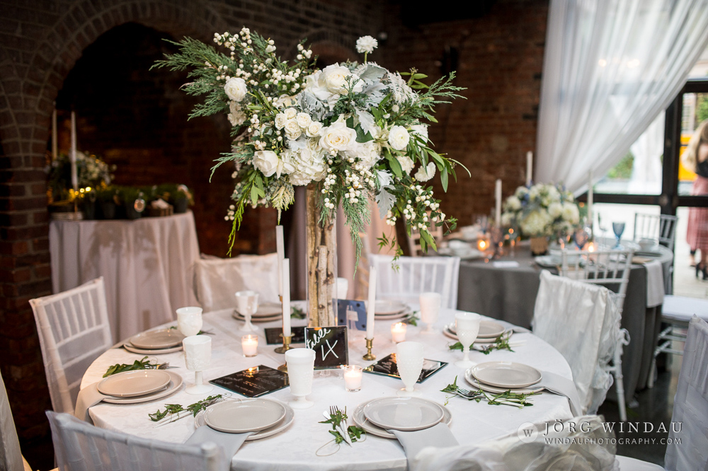 all white wedding reception with green and white centerpiece