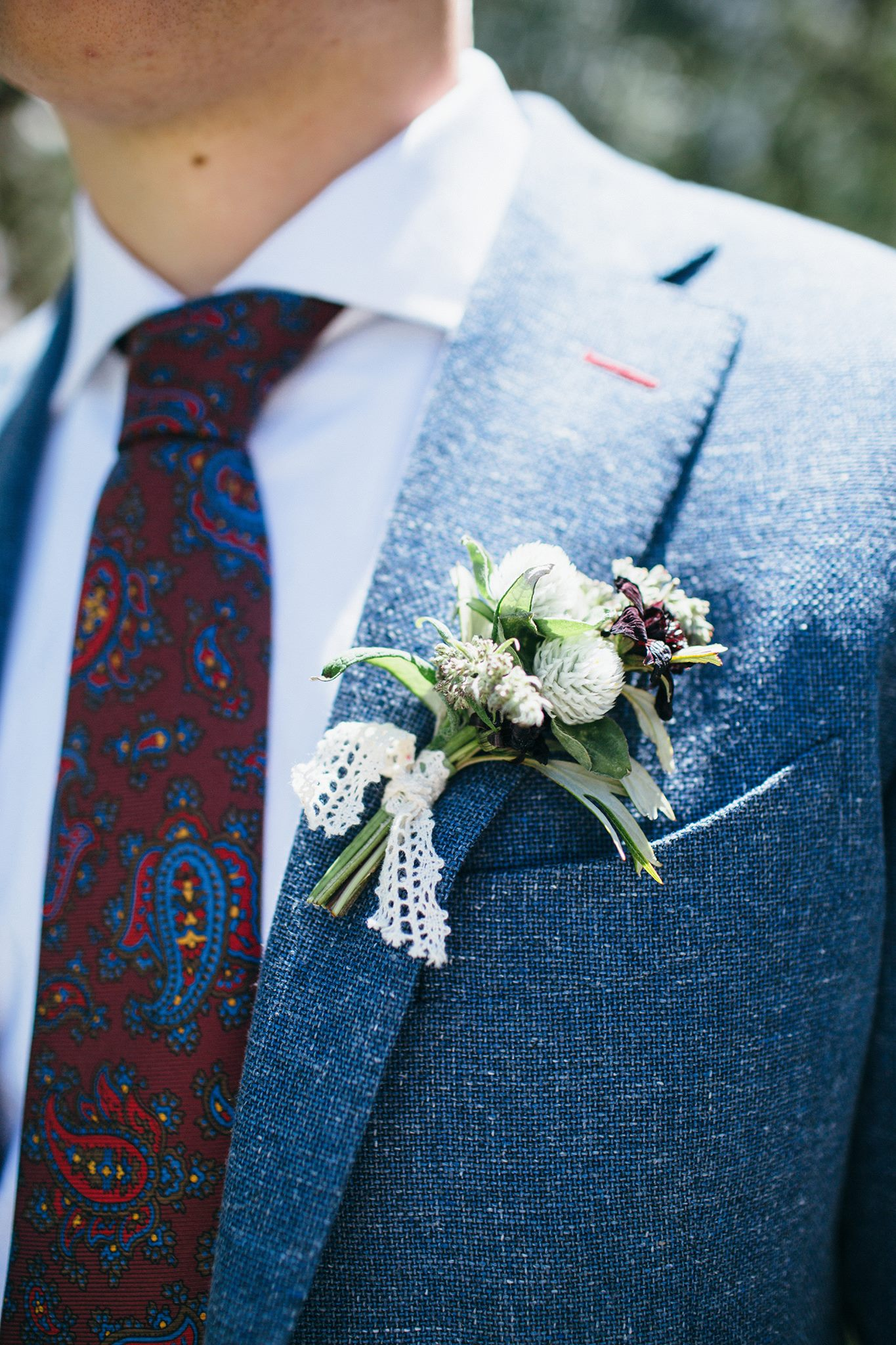 charcoal blue groom's suit with boutineer