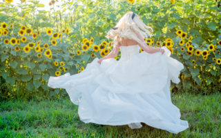 bride twirling in ballgown
