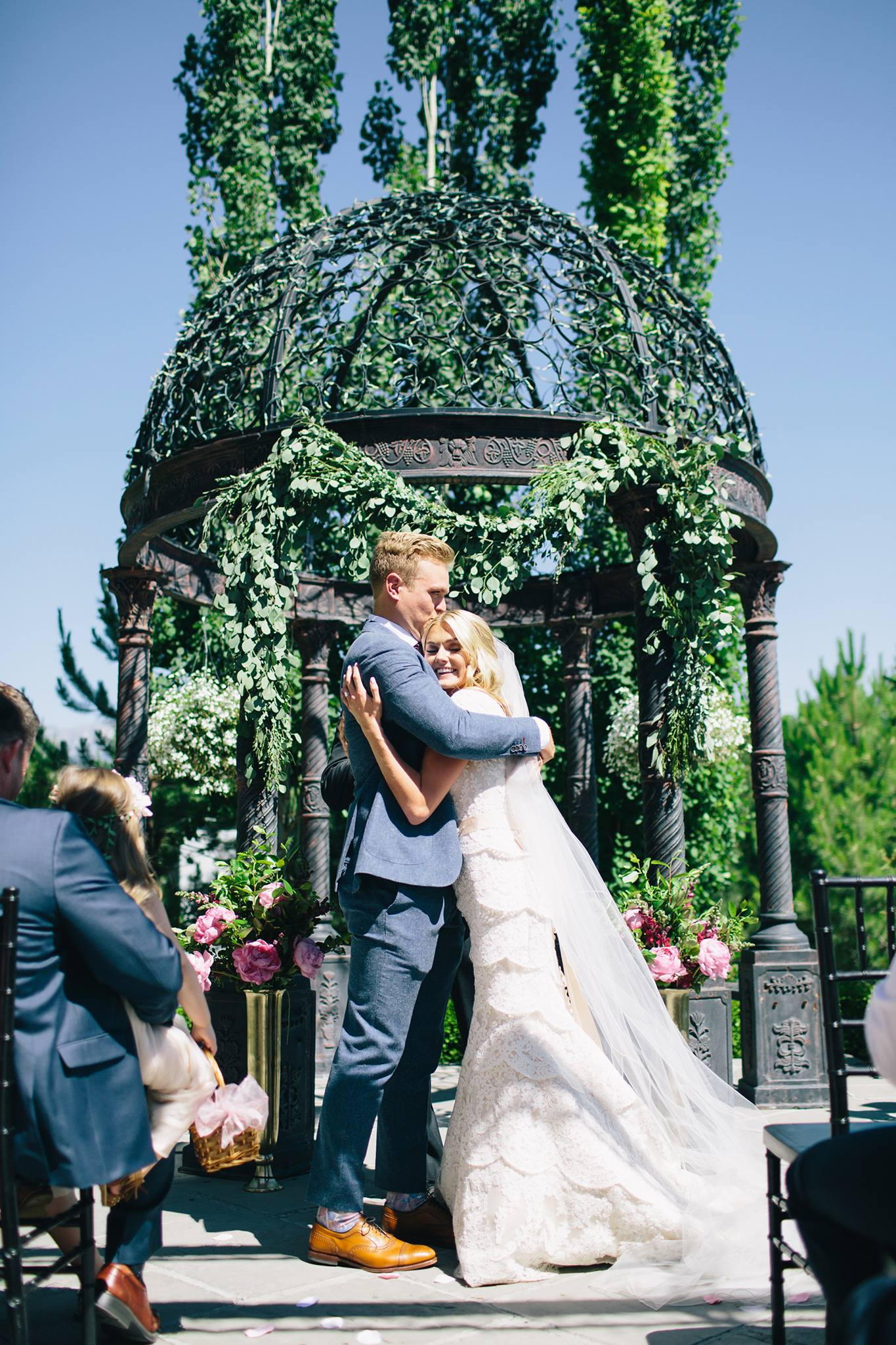 bride and groom embrace at ceremony