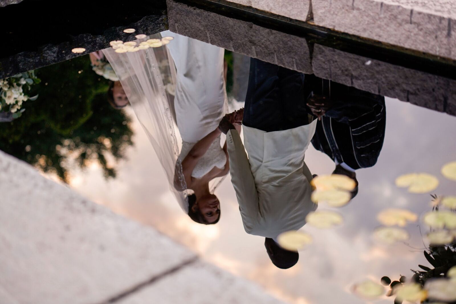 reflection of bride and groom