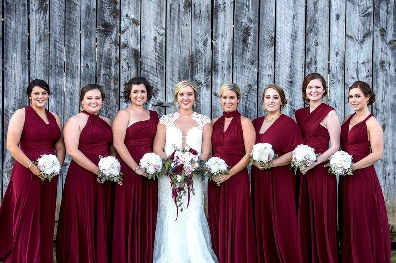 bridesmaids in red gowns