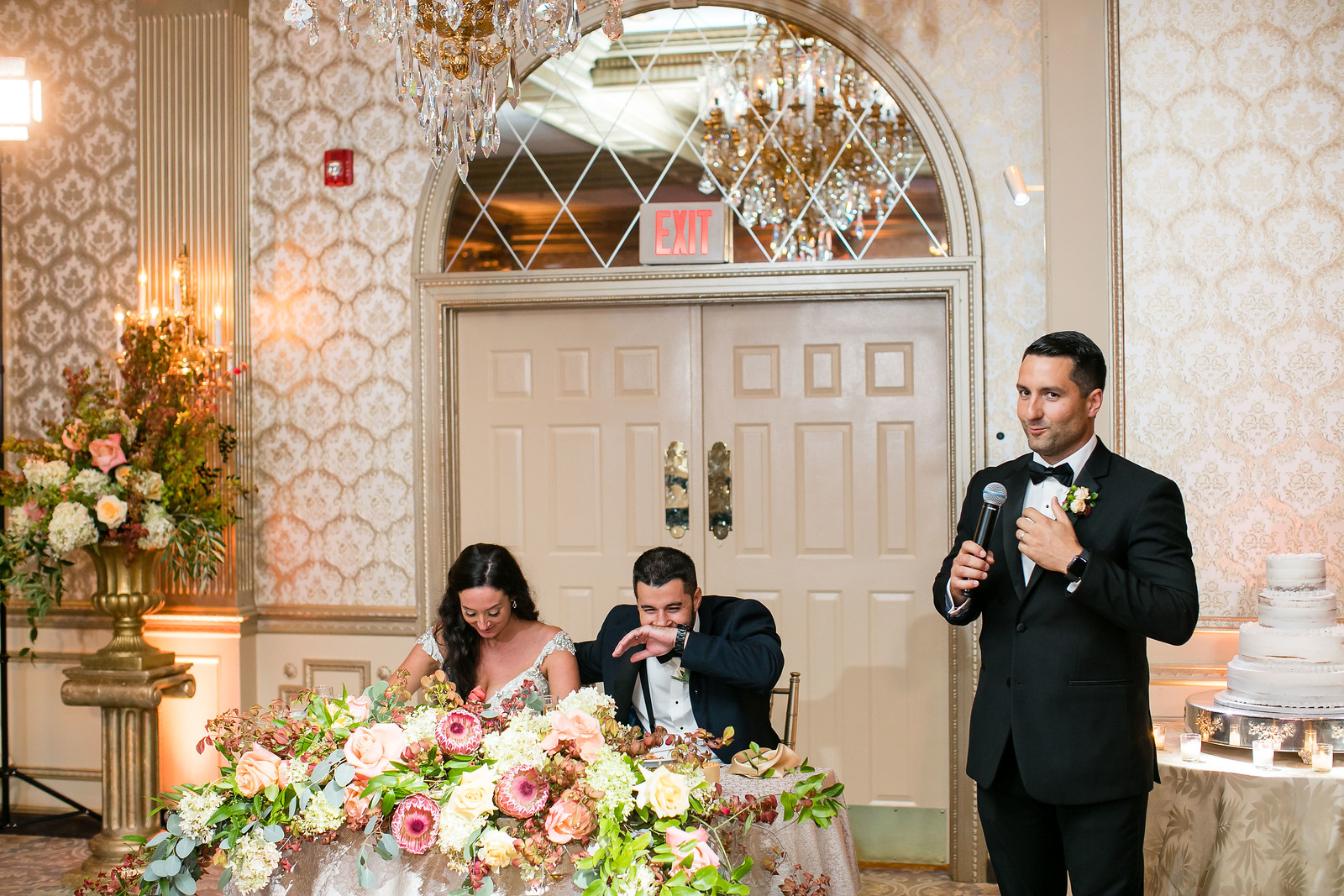 bride and groom laughing at best man wedding toast