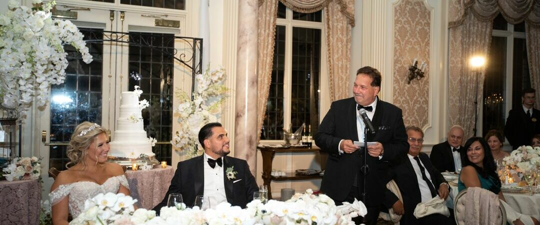 bride and groom listening to father of the bride wedding toast