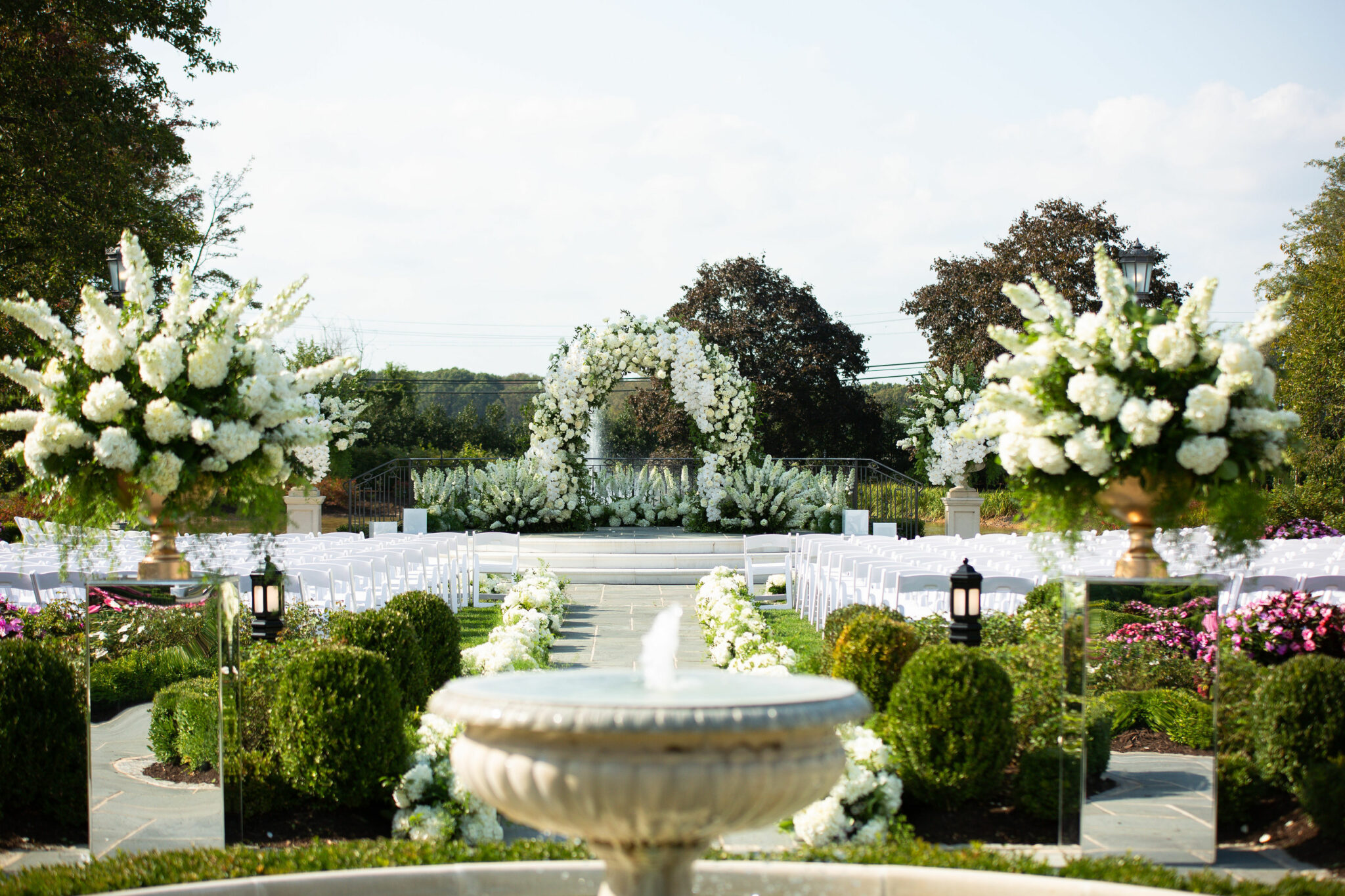 outdoor ceremony space with white and green flowers