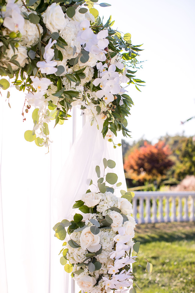white and green flowers on chuppah
