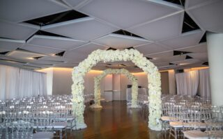 all white floral arch for wedding ceremony