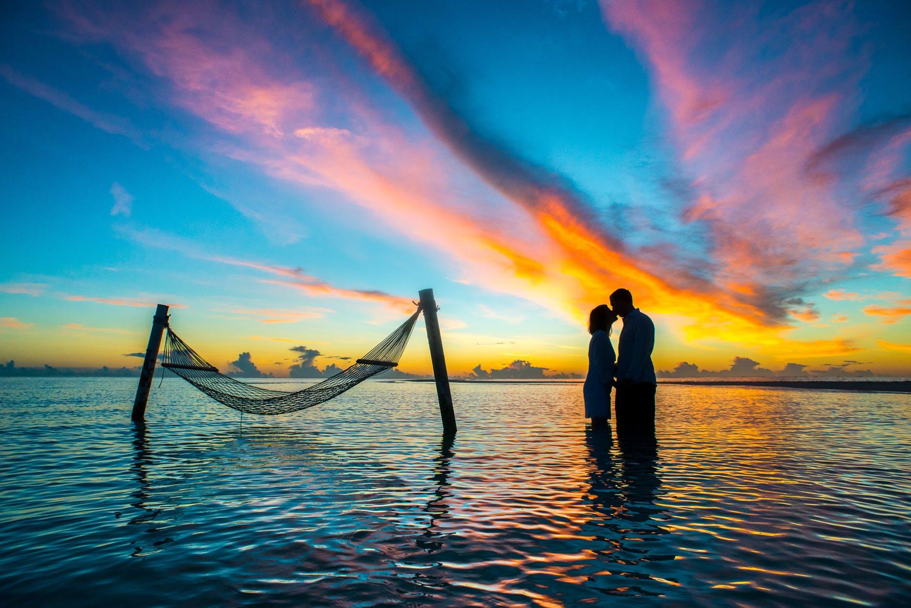 couple in shadow in ocean