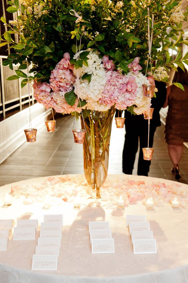 pink and white flowers escort card table