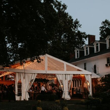 outdoor wedding with house and tent