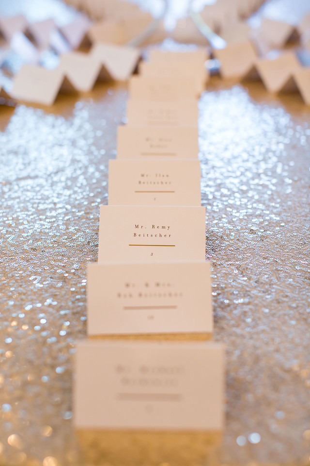 escort cards on sequin tablecloth