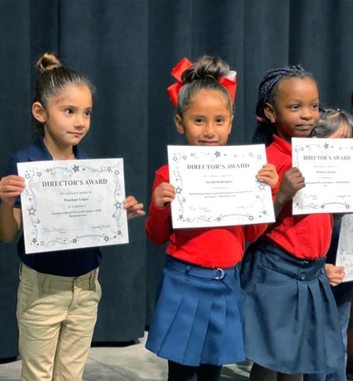 Photo: Students holding awards