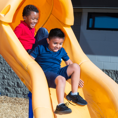 Photo: Kids sliding down slide