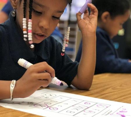 Photo: Preschool student working on paper